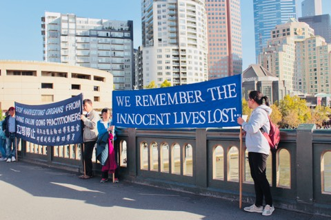 Photo by Tina Wang. In Melbourne on Princes Bridge acknowledging all lives that have been lost.