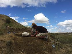 Excavating the first bone. Credit: David Burnham.
