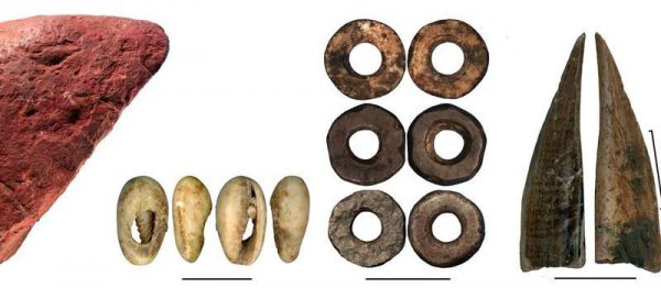 Worked red ochre; bead made of a sea shell; ostrich eggshell beads; bone tool; close-up of the bone tool showing traces of scraping. (from left to right). (Credit: Francesco D'Errico and Africa Pitarch)