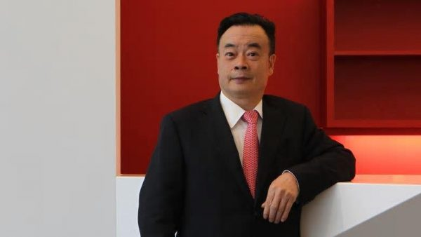 In Australia, a China-born Australian citizen and billionaire has been accused, by the federal parliament, of conspiring to bribe a UN official. (Image: PerthNow/Screenshot)