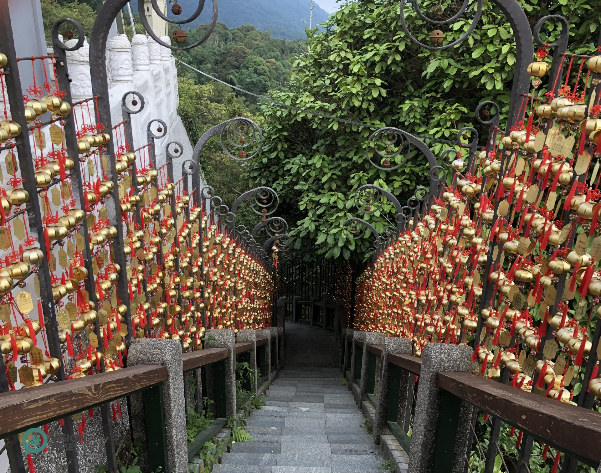 """There are many wind chimes hung on the two sides of the """"Stairway to Heaven"""" at Wenwu Temple by visitors. (Image: Julia Fu / Vision Times)"""