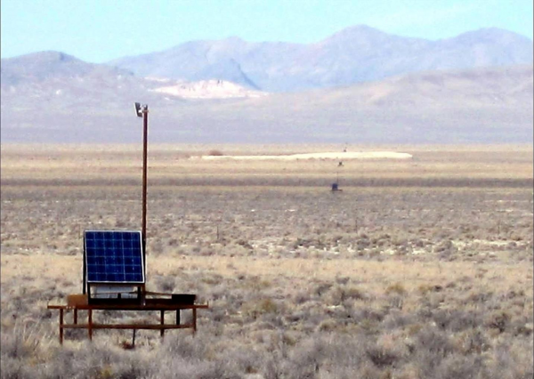 A Telescope Array Surface Detector and its neighbors, deployed in Utah's west desert. The 507 detectors are arranged on a grid covering 700 square kilometers, about the same as the land area of New York City. (photo courtesy of the Telescope Array collaboration)