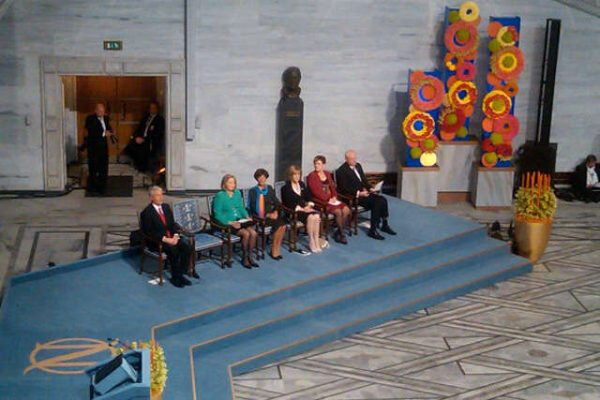 The Nobel Prize for Peace 2010 ceremony: empty chair on the stage booked for Liu Xiaobo, who was in prison on that time; Chinese government also didn't allow Liu Xia travel to Oslo, putting her under house arrest. (Image: wikimedia / CC0 1.0)