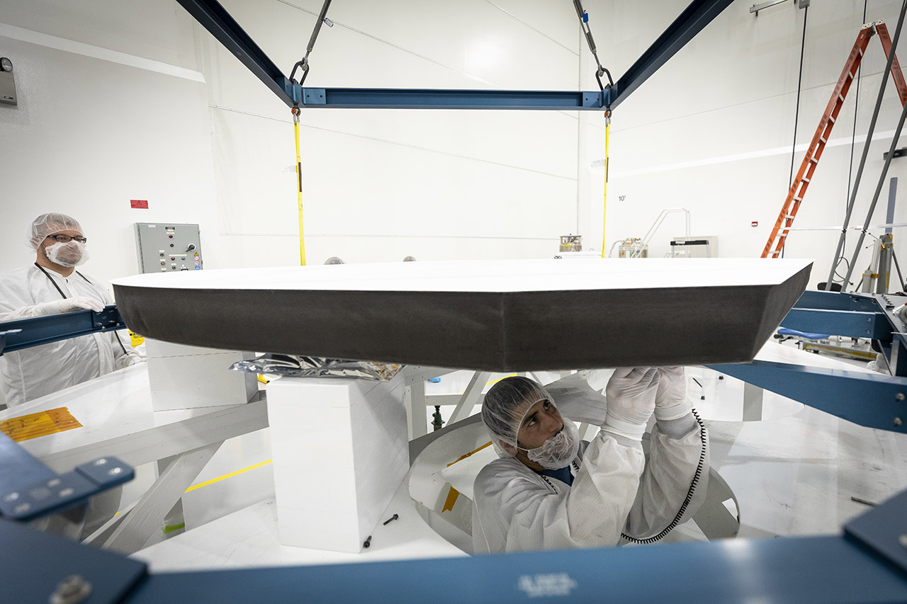 Parker Solar Probe's heat shield is made of two panels of superheated carbon-carbon composite sandwiching a lightweight 4.5-inch-thick carbon foam core. To reflect as much of the Sun's energy away from the spacecraft as possible, the Sun-facing side of the heat shield is also sprayed with a specially formulated white coating. (Image: NASA/Johns Hopkins APL/Ed Whitman)