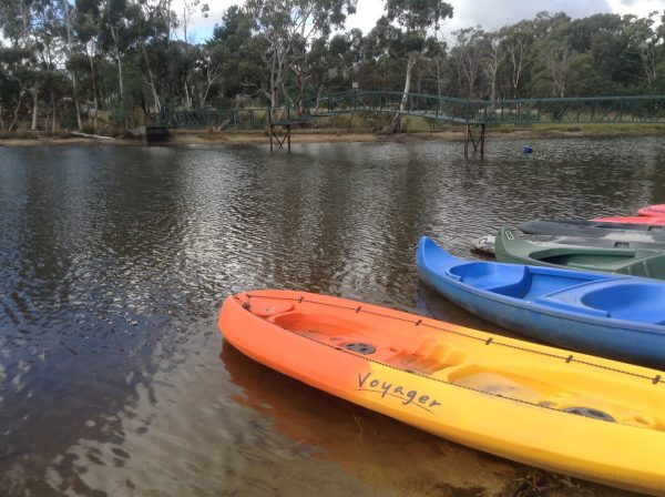 Kayaks for hire docked by the Kyneton Resort Lake.Image by Trisha Haddock.
