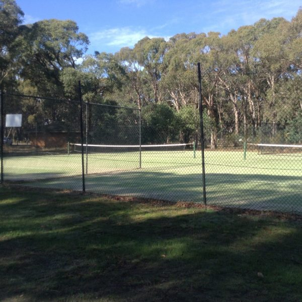 Tennis courts at the Kyneton Bushland Resort. Image by Trisha Haddock.