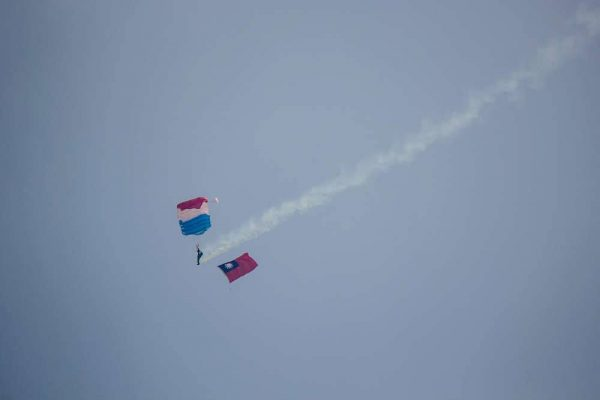 The ROC Army Skydiving Team performs descending with ROC national flag at the air show. (Image: Courtesy of Wang Chia Yi)