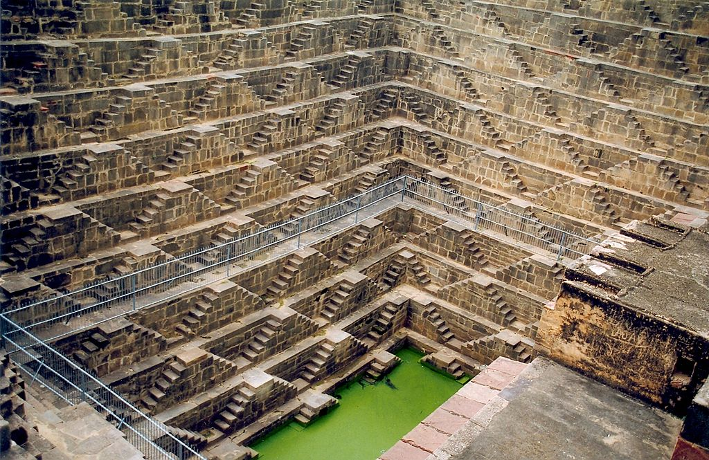 Chand Baori is a step well built in 800 AD and is a magnificent ode to geometry. (Image: Doron via wikimedia CC BY-SA 3.0)