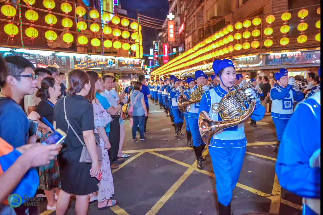 The Falun Dafa Tian Guo Marching Band has participated in the Keelung Ghost Festival celebrations many times in recent years. (Image: Niou Chi-Ping / Vision Times)
