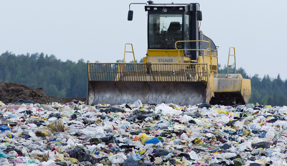A vehicle in a landfill.