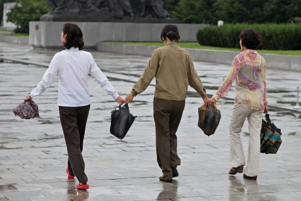 North Korean women carrying merchandise in Pyongyang. The North Korean government emphasized economic development, not ballistic missiles, in a recent National Day celebration. (Image: via Flickr CC BY-SA 2.0)