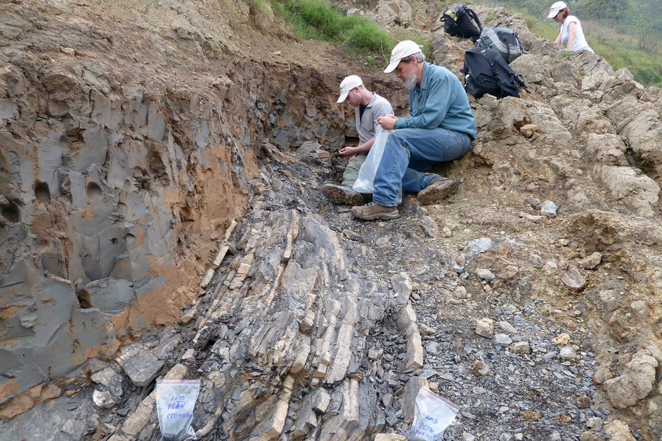 Sam Bowring (front) and former graduate student Seth Burgess inspect the End-Permian extinction horizon at Penglaitan. (Image: Image: Shuzhong Shen)