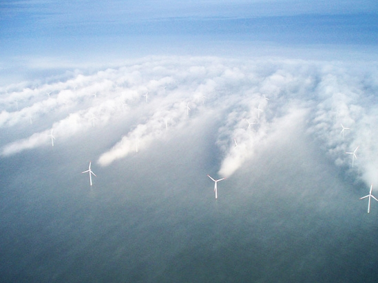 Fog at an offshore windfarm shows the formation of wind shadows between wind turbines. Photo Credit: VATTENFALL)