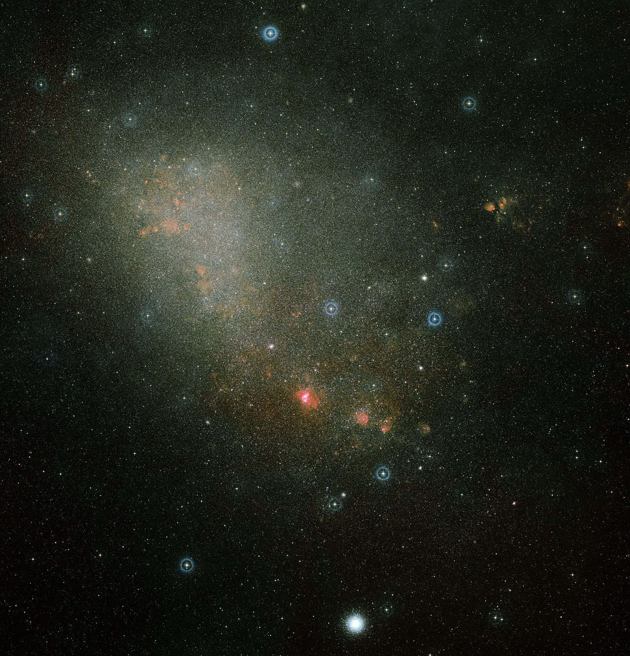 This image shows an overview of the full Small Magellanic Cloud and was composed from two images from the Digitized Sky Survey 2, which digitized photographic surveys of the night sky. Image credit: Davide De Martin (ESA/Hubble)