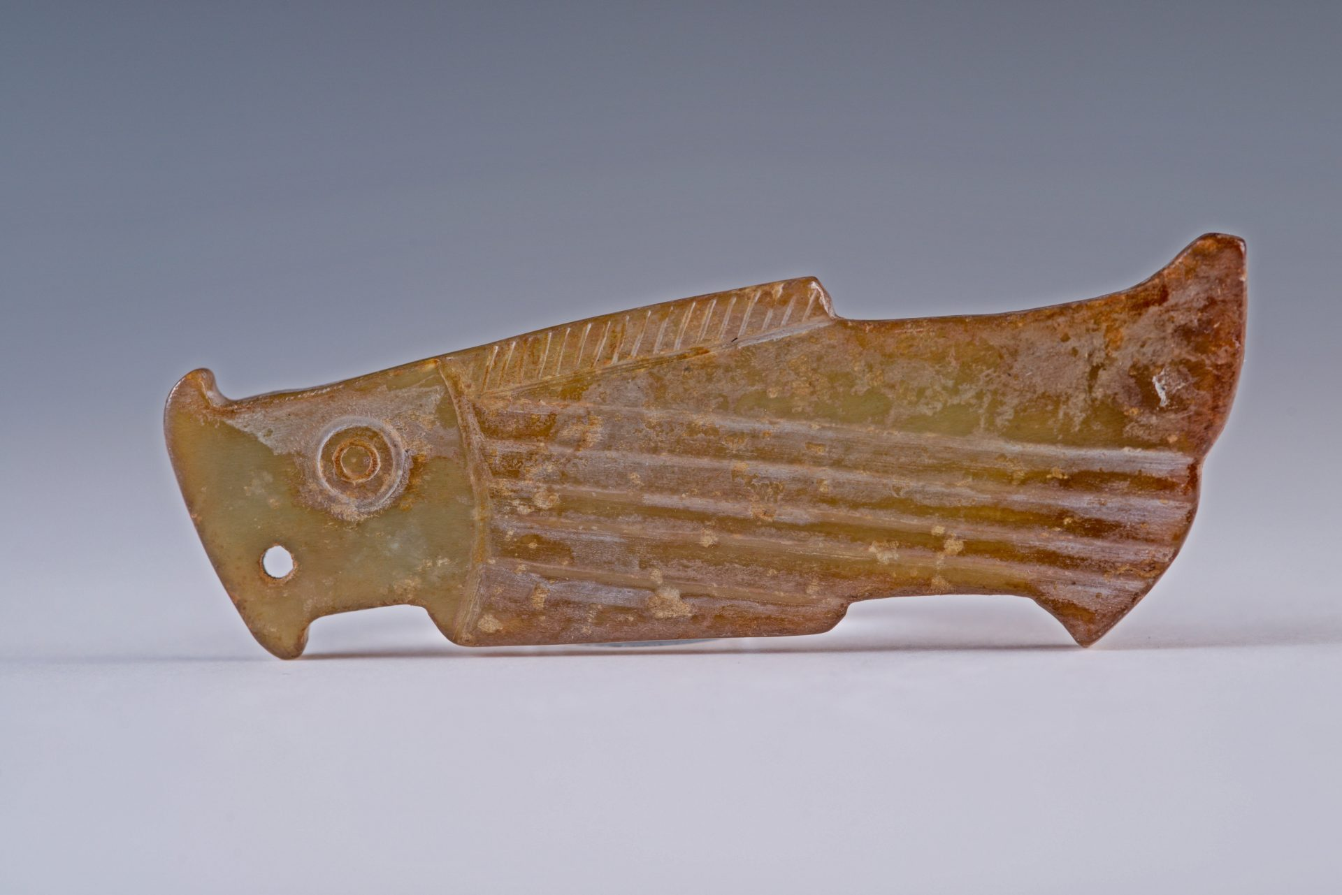 A fish jade pieces from from the Shang and Zhou Dynasties. (Image: Courtesy of Yens Charity Foundation)