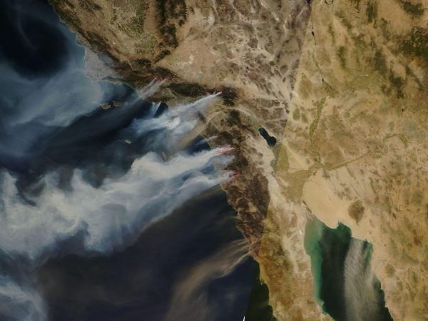 """Santa Ana winds in California expands fires and spreads smoke over hundreds of miles, as in this October 2007 satellite image shows.""(Image: Nasa [Public domain], via Wikimedia Commons)"