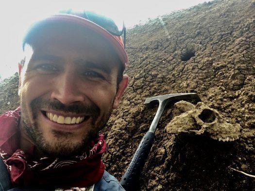 Tyler Faith surveying Pleistocene outcrops in western Kenya, where he has conducted fieldwork since 2009. (Image: J. Tyler Faith)