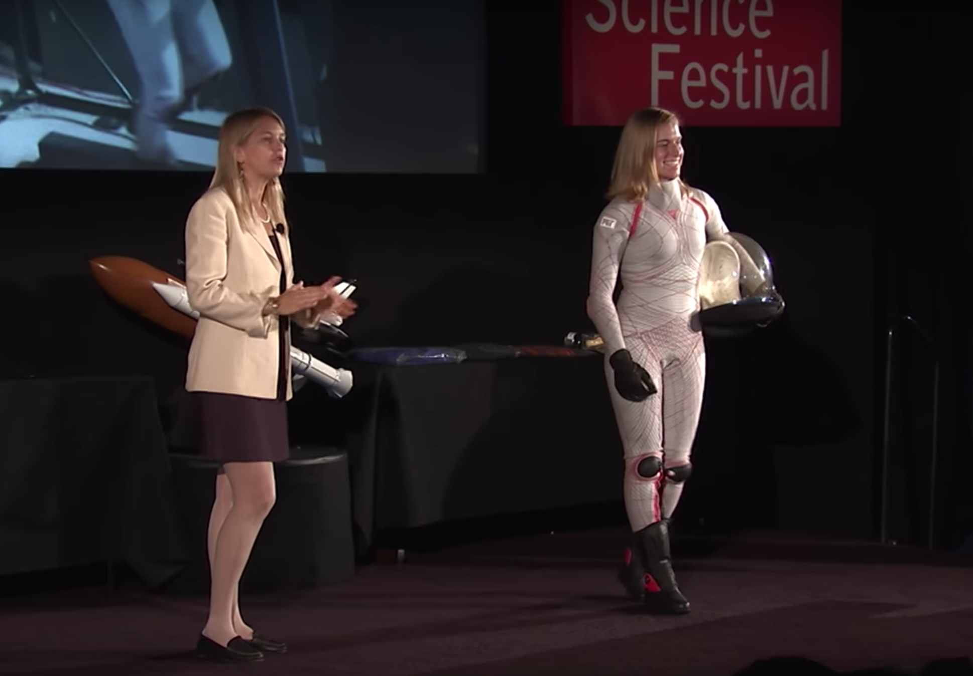 Dr. Dava Newman reveals her spacesuit prototype at the World Science Festival. (Image: YouTube/Screenshot)
