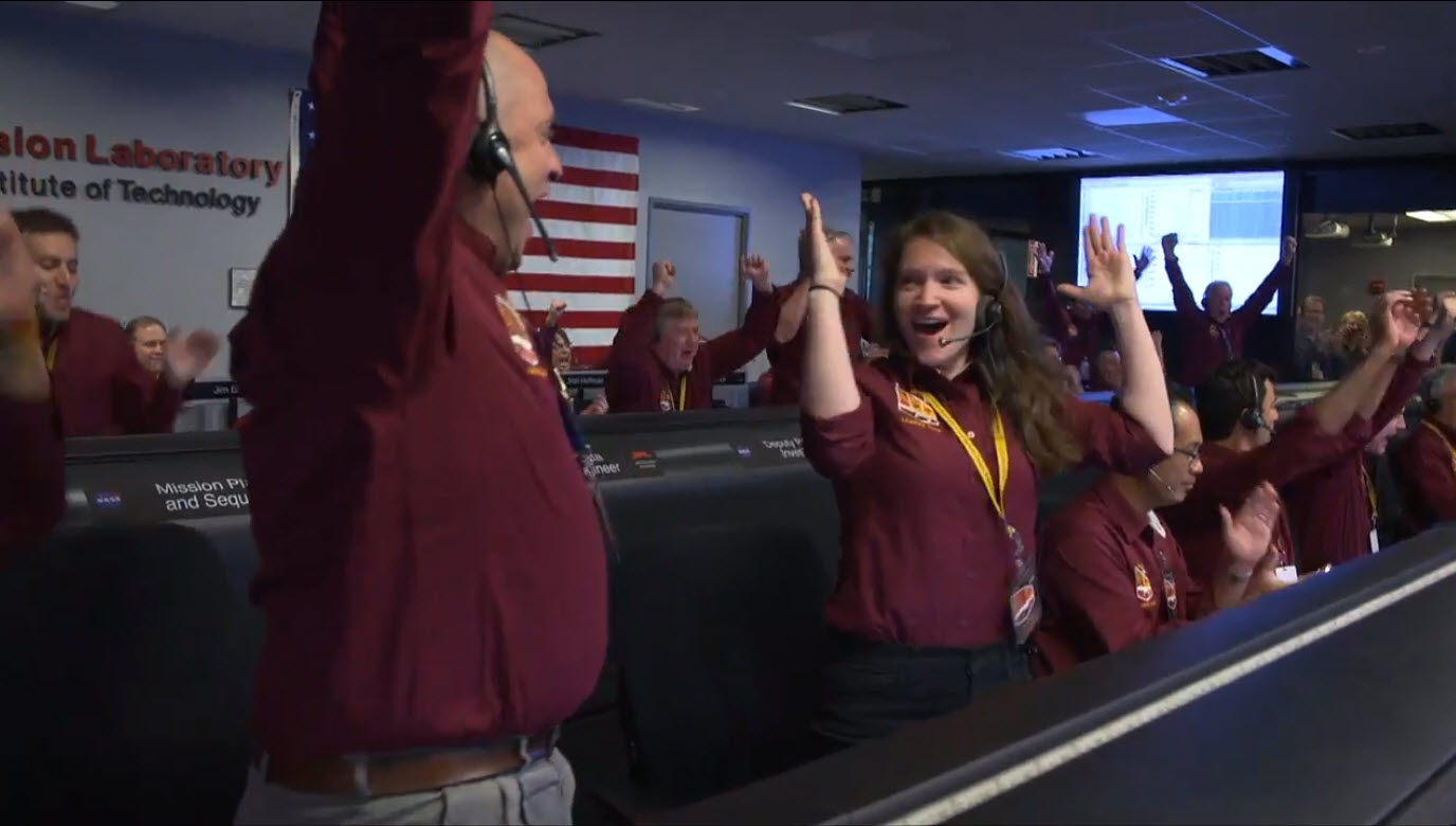 The NASA InSight team reacts after receiving confirmation that the spacecraft successfully touched down on the surface of Mars, inside the Mission Support Area at NASA's Jet Propulsion Laboratory in Pasadena, California. (NASA/B. Ingalls)