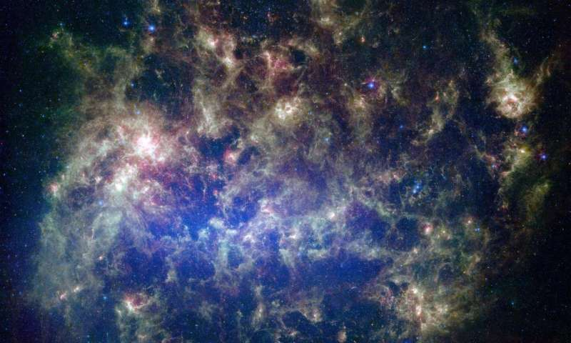 This vibrant image from NASA's Spitzer Space Telescope shows the Large Magellanic Cloud, a satellite galaxy to our own Milky Way galaxy. (Credit: NASA/JPL-Caltech/STScI)
