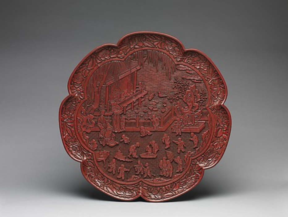 Tray with Women and Boys on a Garden Terrace, 14th century, Yuan dynasty (1271–1368), carved red lacquer. (Image: MOMA)
