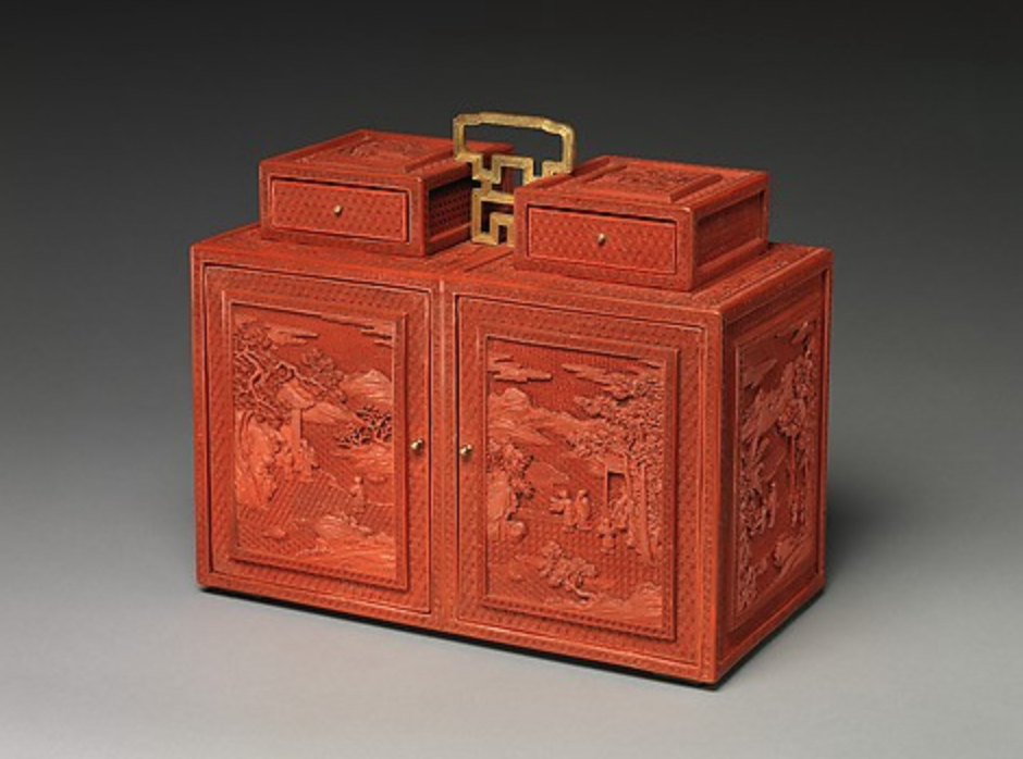 Cabinet with Figures in a Landscape, 18th century, Qianlong period (1736–95), Qing dynasty (1644–1911), carved red lacquer; gilt bronze fittings. (Image: The Met)