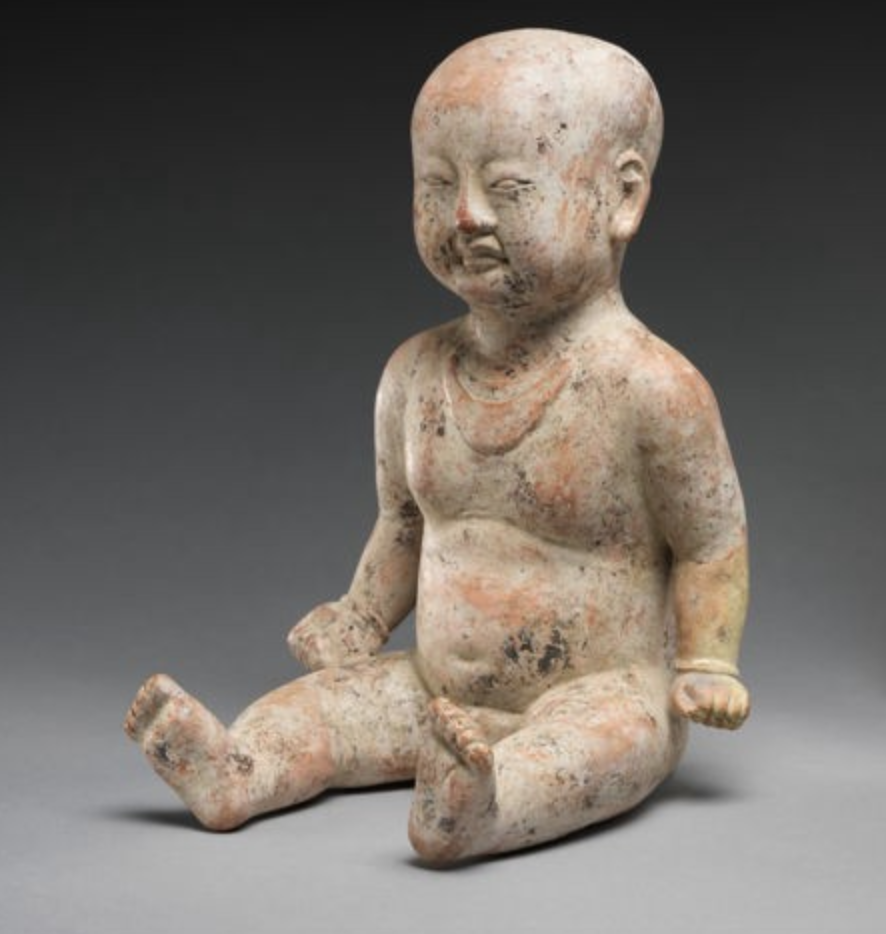 Sitting Boy, 12th century, Song Dynasty (960–1279), pottery with slip. (Image: The Met)