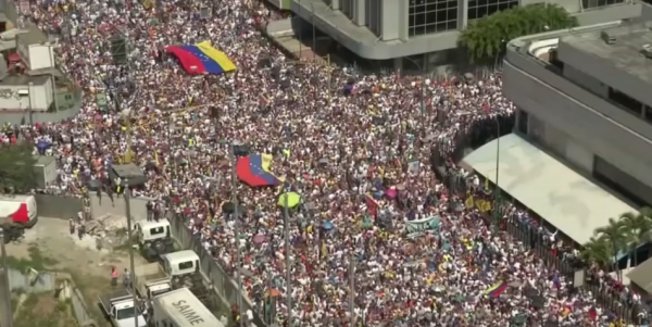 "On January 23, 2019, more than 100,000 Venezuelans flocked the streets of Caracas and chanted ""Maduro, Step Down."" (Image: YouTube/Screenshot)"