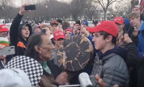 """""""You won't get any further reaction of aggression, and I'm willing to stand here as long as you want to hit this drum in my face,"""" said Sandmann in explanation of his expression. (Image: YouTube/Screenshot)"""
