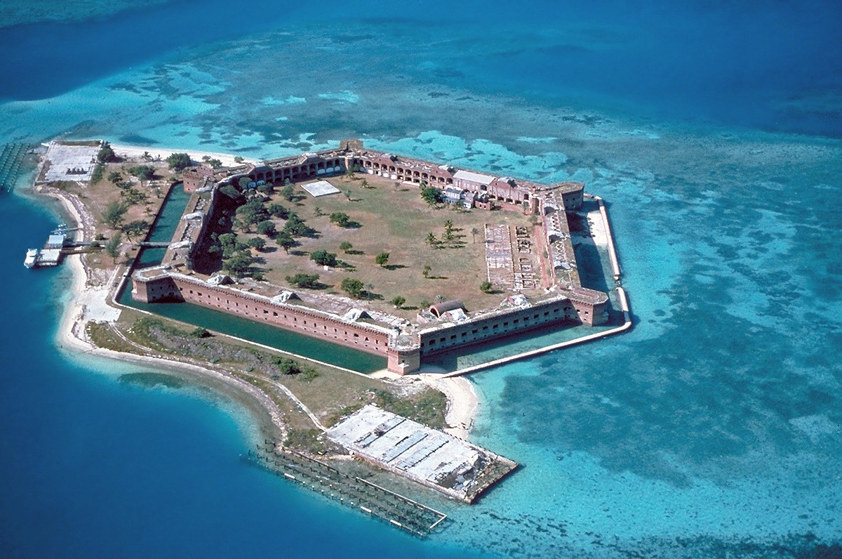 Fort-Jefferson Dry-Tortugas. As seen easily in the photo, the clear waters in shallow areas surrounding the fort are popular for snorkeling and SCUBA.