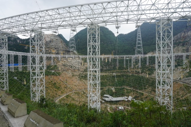 The Five-hundred-meter Aperture Spherical radio Telescope (FAST) during its construction in Guizhou Province, China. (Image: Psr1909 via wikimedia CC BY-SA 4.0)