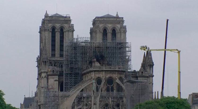 Notre Dame's medieval masonry remained intact, shielding much of the lower interior from further damage. (Image: YouTube/Screenshot)
