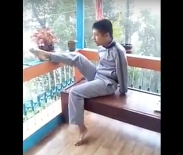 In India, Bikram Bhattarai who was born without hands, is evoking feelings of awe in the media. (Image: YouTube/Screenshot)