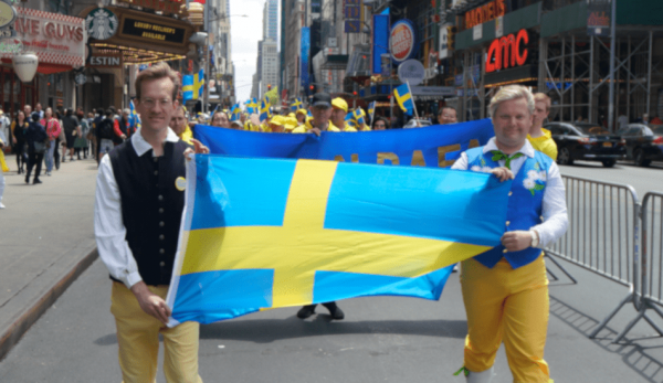 A group from Sweden display their nation's flag. (Image: David Yang)
