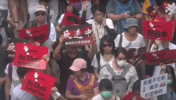 A number of current and former Legislative Council members led the protest holding placards and calling for Carrie Lam, the chief executive of Hong Kong, to step down. (Image: YouTube/Screenshot)
