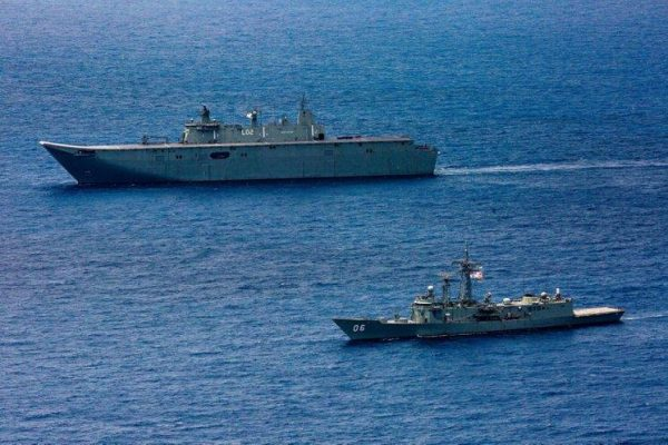 The HMAS Canberra and HMAS Newcastle sail in formation during Indo-Pacific Endeavour 2019. (Image: Navy Daily / CC0 1.0)