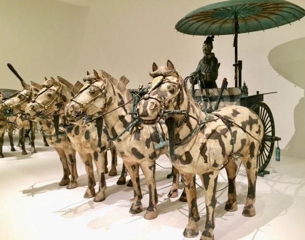 Qin Dynasty Chariot on display at NGV. These carriages like this were known to be used in battle for the Emporer to inspect his soldiers. Carriages on display at NGV. The two medium-sized horses and carriage were found in the tomb.  (Image: Trisha Haddock)