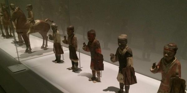 On display at NGV. These tiny warriors were found in 1965 at Yangjawan. A terracotta army with more than 2400 horses was found with riders and standing figures with shields. This site is believed to be apart of the burial complex of the first Han Emperor Guozu.  (Image: Trisha Haddock)