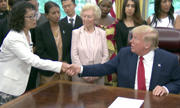 President Donald Trump shakes hands with Zhang Yuhua, a Falun Gong practitioner who survived persecution in China, at the White House on July 17, 2019. (Image: The White House)