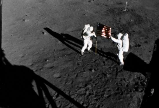 "Neil A. Armstrong (left) and Edwin E. ""Buzz"" Aldrin, Jr. (right) with the flag on the Moon during the Apollo 11 extravehicular activity. (Image: NASA PHOTO S69-40308)"