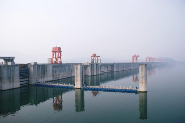 The Three Gorges Dam forced the relocation of 1.2 million people and the destruction of many ancient sites. (Image: Hugh Llewelyn via Flickr CC BY-SA 2.0)