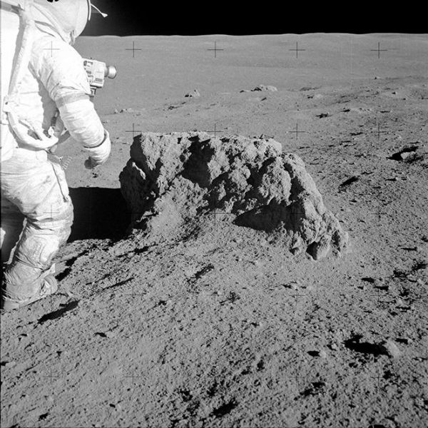 Astronaut Alan B. Shepard Jr., Apollo 14 commander, stands beside a large boulder on the lunar surface during the mission's second extravehicular activity (EVA) on 6 February 1971. (Image: NASA)