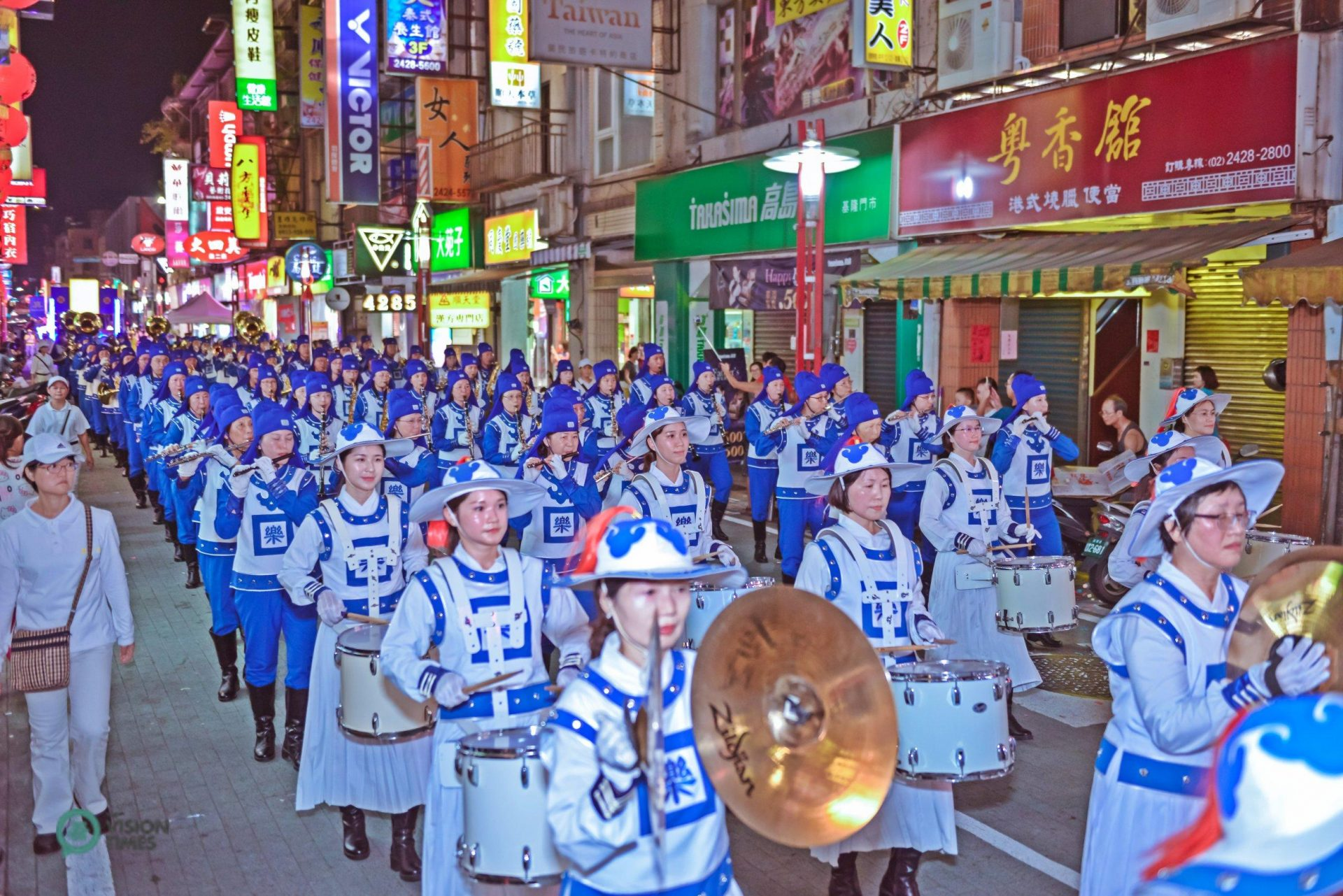 The Falun Dafa Tian Guo Marching Band is one of the most popular performing groups in the procession. (Image: Johnny Lin / Vision Times)