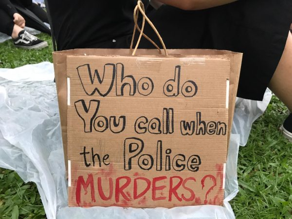 "Paper Bag of a Hong Kong Protester, saying ""who do you call when the police murders?"