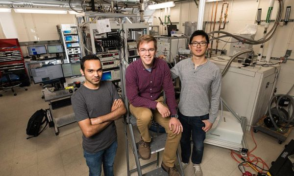 John Nichol and PhD students Yadav Kandel, left, and Haifeng Qiao, right, demonstrated a way to manipulate electrons and transmit information quantum-mechanically, bringing scientists one step closer to creating a fully functional quantum computer. Quantum computers will be able to perform complex calculations, factor extremely large numbers, and simulate the behaviors of atoms and particles at levels that classical computers cannot. (University of Rochester photo / J. Adam Fenster)
