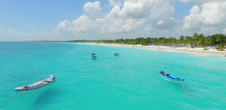 Beach and coral-blue water, Tulum, Mexico.