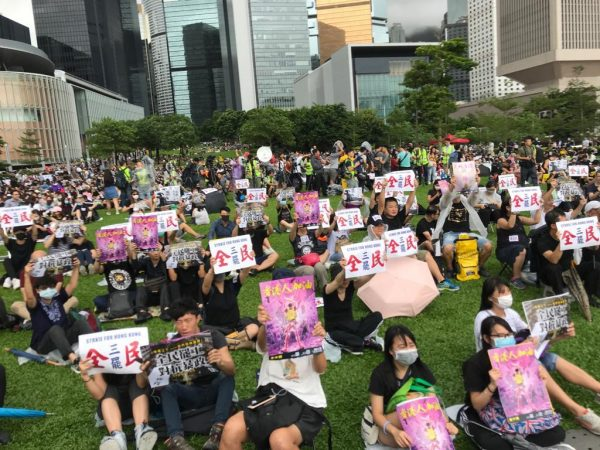 Hong Kong protesters gather in a park to peacefully protest, demanding the five things.