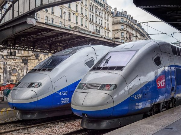 TGVs at the Gare de l'Est in Paris. Operated by the state-owned SNCF, it holds the world record for the fastest wheeled train, reaching 574.8 km/h (357.2 mph) during tests in 2007. (Image: Ermell via wikimedia CC BY-SA 4.0)