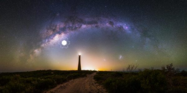 This 28 image photomosaic captures the arch of the milky way over the Guilderton Lighthouse in Western Australia, and the Large and Small Magellanic Clouds. The location of a supernova that would have exploded 9,000 years ago and been visible in the night sky is shown in the image. (Image: Paean Ng / Astrordinary Imaging)
