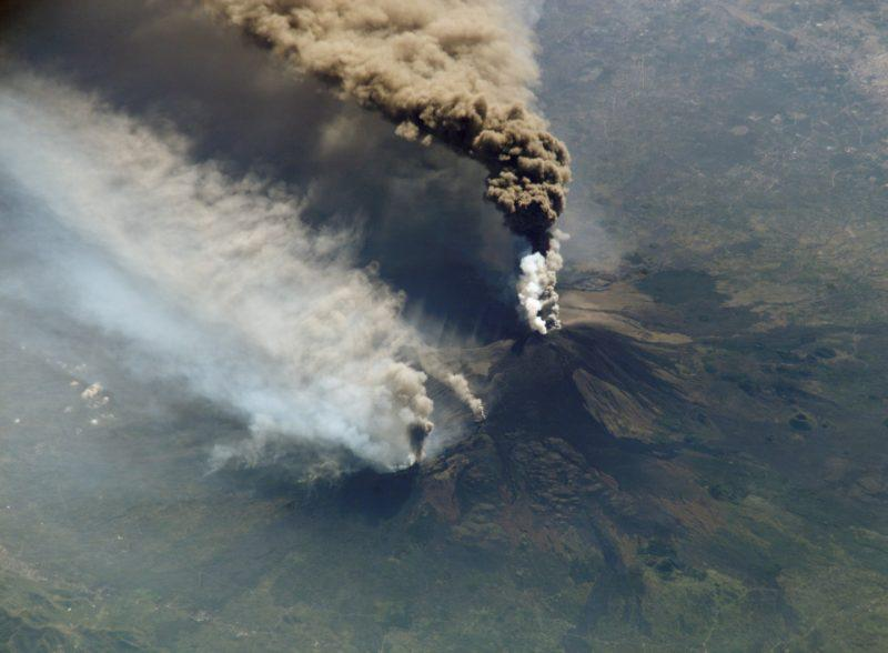 An image of an eruption at Mount Etna on October 30, 2002 from the International Space Station. The eruption, triggered by a series of earthquakes, was one of the most vigorous in years. Ashfall was reported in Libya, more than 350 miles away. (Image: NASA)